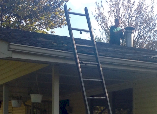 Randy Morse of Chim-Kleen doing the roof work involved in Chimney Cleaning.